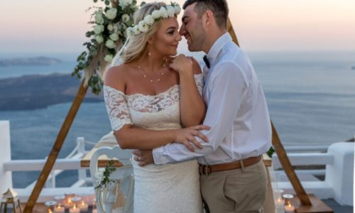 Dreamy Budget Elopement Santorini couple posing at sunset
