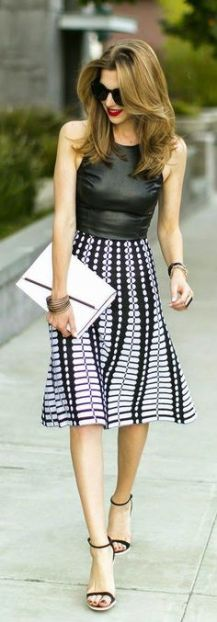 Street style   Black leather top and printed skirt.