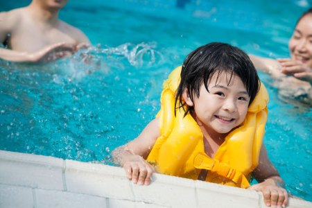 child wearing life vest in pool
