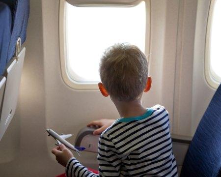 boy sitting on plane