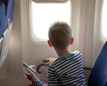 boy sitting on plane
