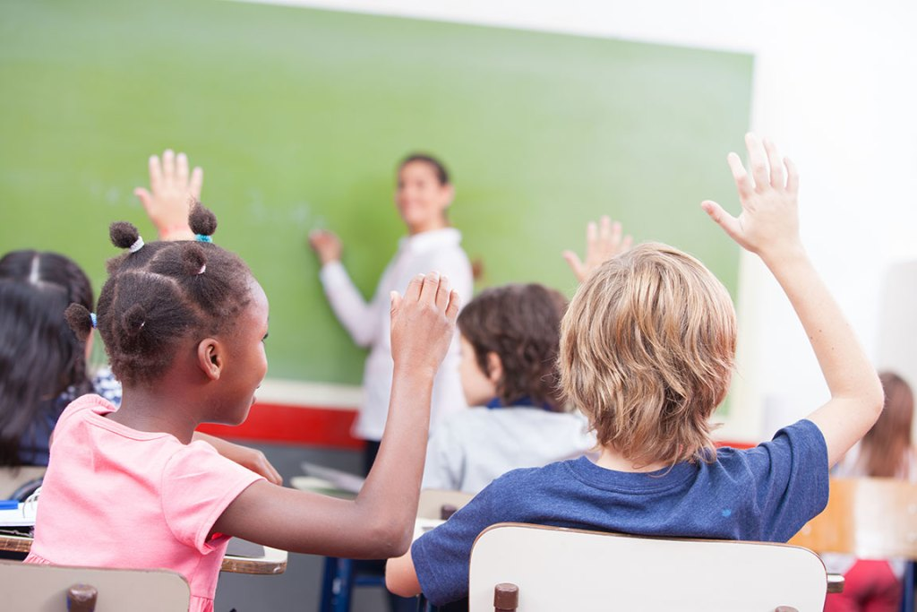 kids answering questions in class