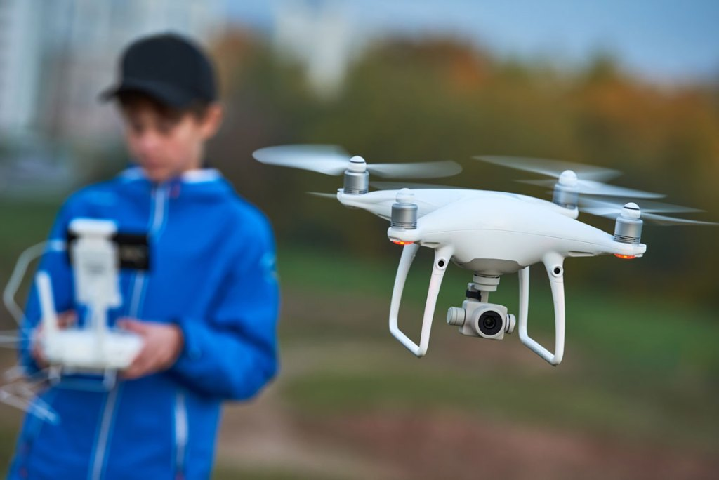 young boy piloting drone