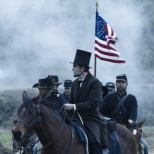 """In this undated publicity photo released by DreamWorks and Twentieth Century Fox, Daniel Day-Lewis, center, as President Abraham Lincoln, looks across a battlefield in the aftermath of a terrible siege in this scene from director Steven Spielberg's drama """"Lincoln."""" """"Lincoln"""" opens in limited release Nov. 9, 2012, and nationwide Nov. 16, just after the U.S. presidential election. (AP Photo/DreamWorks, Twentieth Century Fox, David James)"""