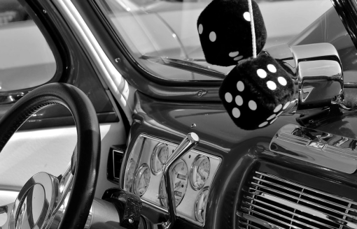 Fuzzy dice in 1950s car
