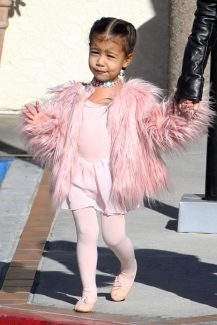 Kourtney Kardashian was spotted toting daughter Penelope and niece North West to ballet class in Los Angeles. Kourtney seemed to be very chipper as her hair flared out in the cool breeze. Pictured: North West Ref: SPL1192439 161215 Picture by: JaX / Splash News Splash News and Pictures Los Angeles: 310-821-2666 New York: 212-619-2666 London: 870-934-2666 photodesk@splashnews.com