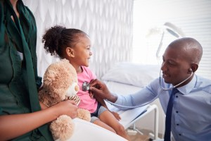 doctor and patient during well child visit