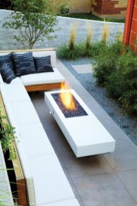 Modern outdoor living area with cozy furniture and firepit Part 20