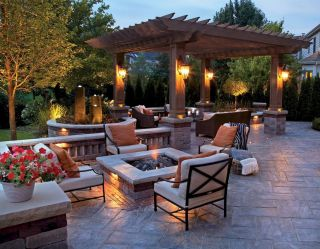 Modern outdoor patio and living area with cozy furniture and firePart 13