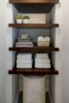 Open shelving and builtin cabinets for lots of extra bathroom storage Part 15