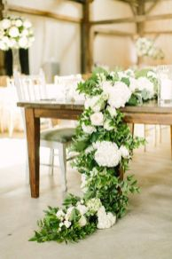 Refreshing spring wedding garland with green and ivory color theme decoration over the walls wedding arch and tables Part 11