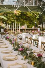 Refreshing spring wedding garland with green pink peach and ivory color themes over the walls wedding arch and tables Part 23