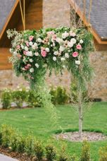 Refreshing spring wedding garland with green pink peach and ivory color themes over the walls wedding arch and tables Part 26