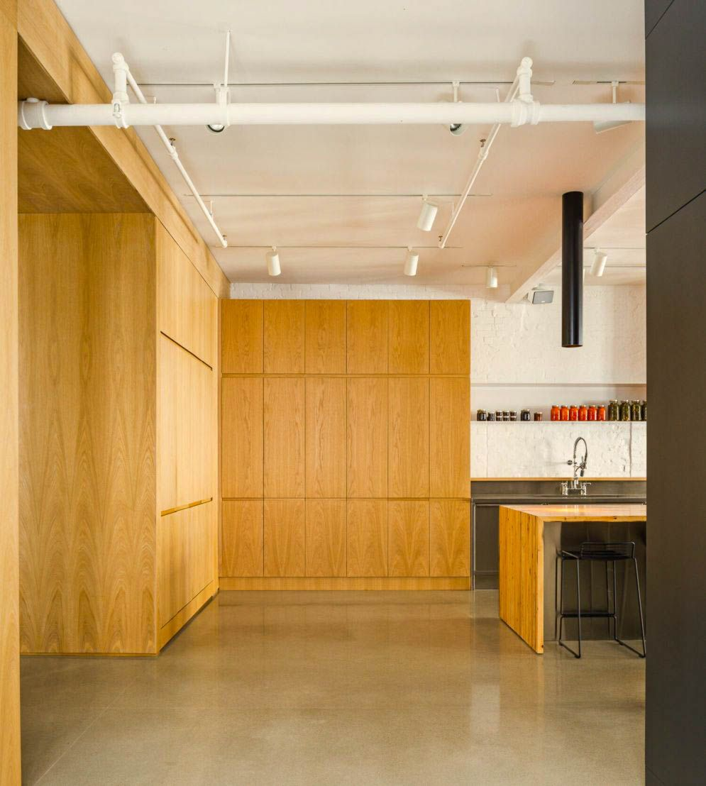 Wood accent as partition and cabinetry in MCGILL 120 renovation for a loft in Vieux Montreal (3)