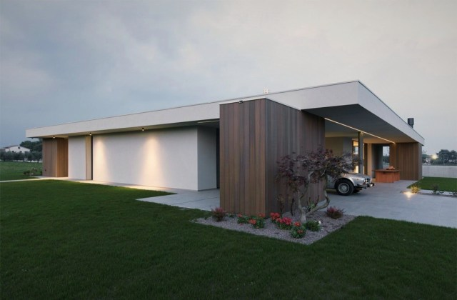 Impressive architecture work underscoring flat roof house style in the middle of green grass field (5)