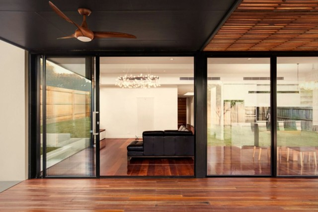 Large glass window and wall granting maximum sun exposure to highlight rich wood color in the glossy finish (4)