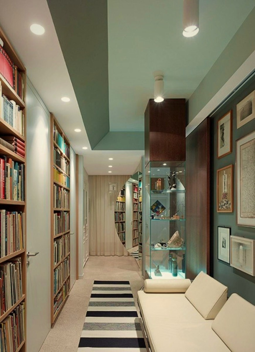 Modern home library design with art wall in Apartment FS Stuttgart (2)