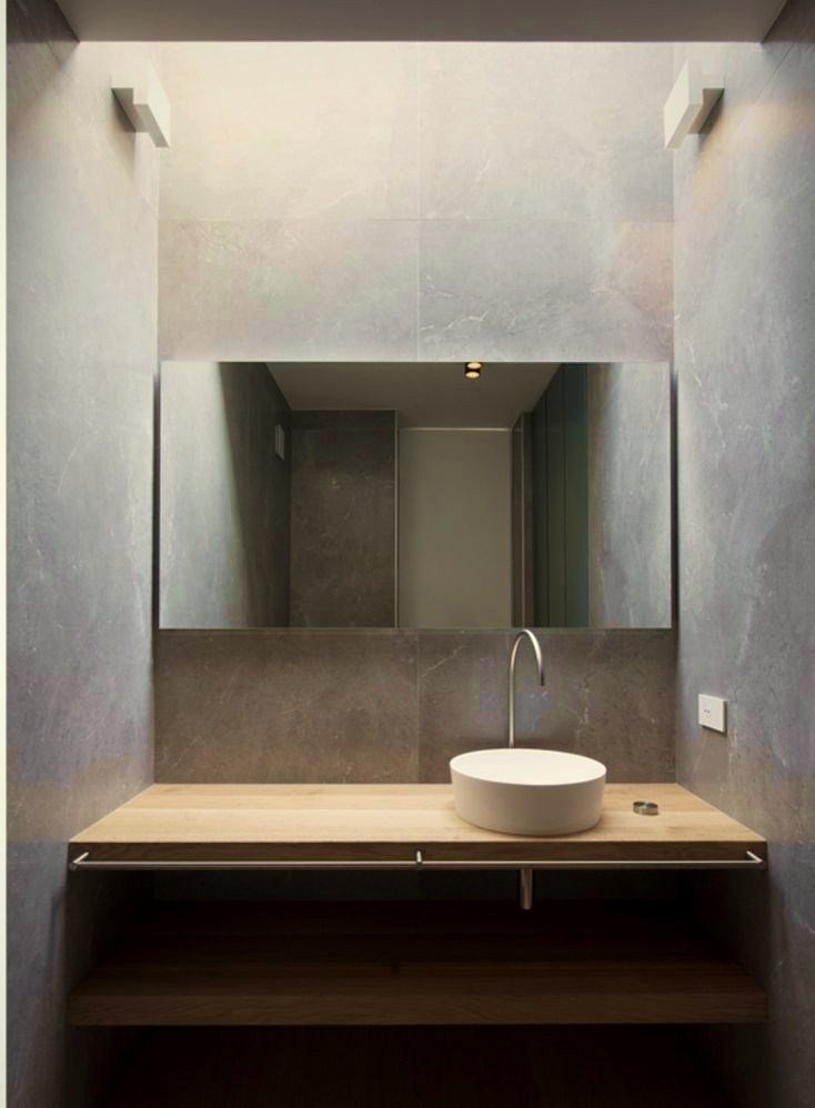 Traditional mix style sink and vanity in greyish bathroom concept giving calming and relaxing vibe to the area