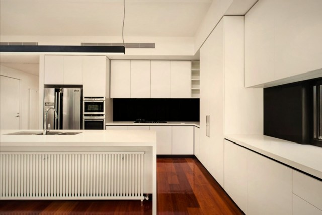 White interior wall and furniture to give simple background to the glossy wooden floor (2)