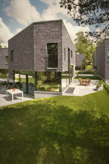 Distinctive house complex with brilliant architecture concept accommodating five family houses (1)