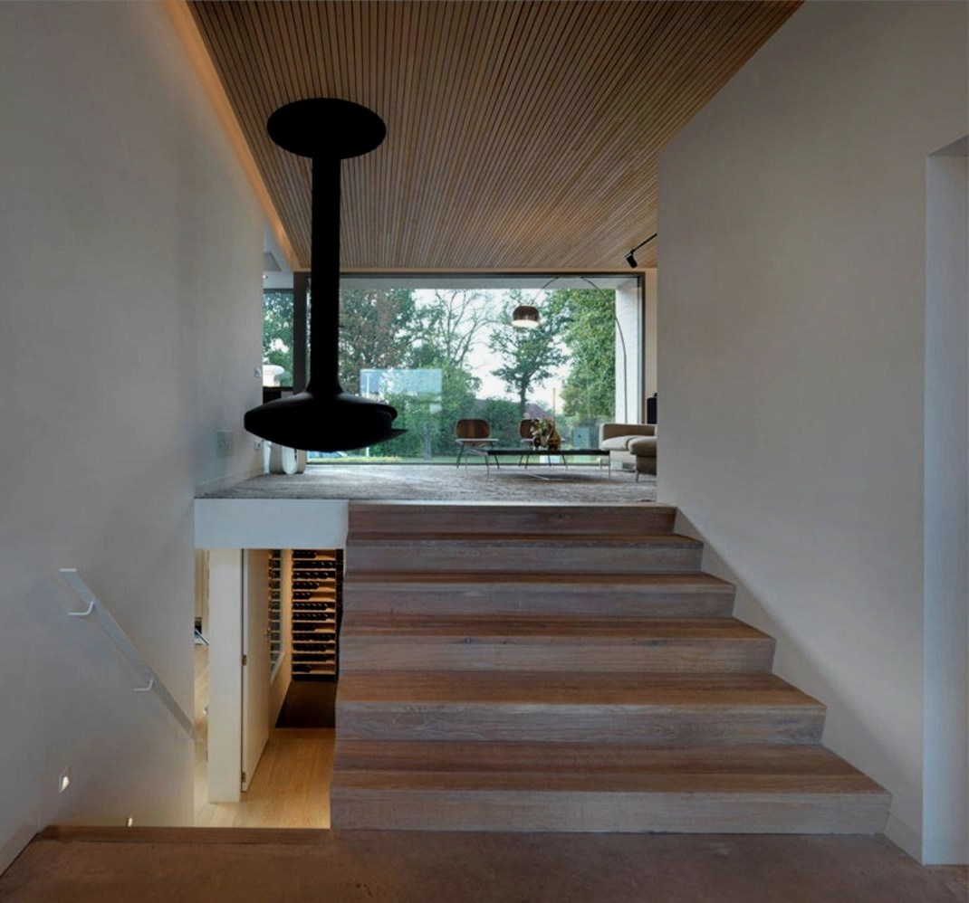 Warm interior concept with eclectic hung chimney to enhance indoor special character (2)