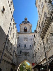 La Rochelle building archway blue sky