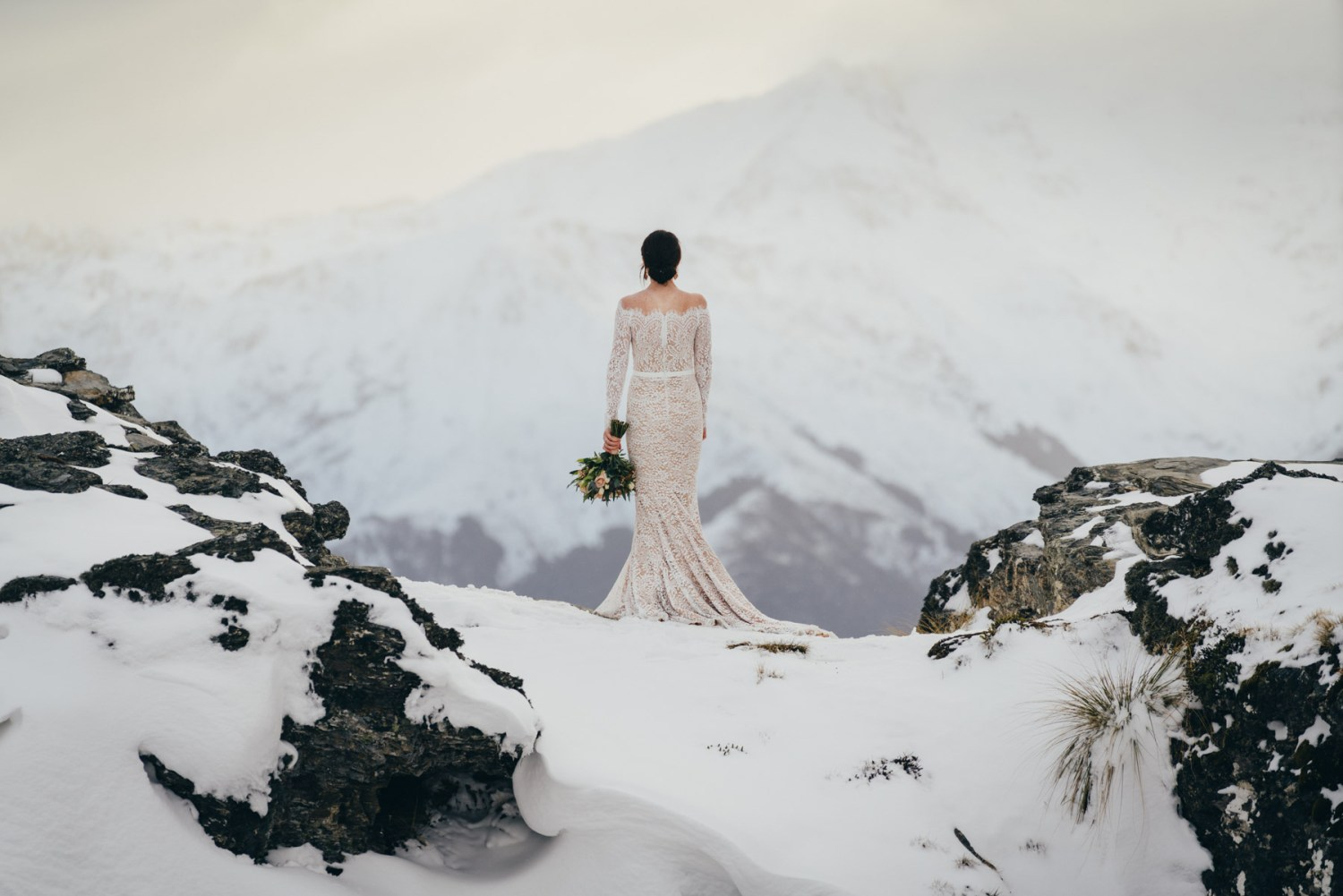 Cecil Peak winter wedding Queenstown, bride on The Ledge