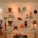 15 Floating Curved Glass Shelves Perfect For Storing Your Belongings 19
