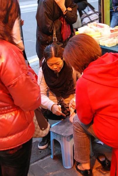 Vendedora callejera en Sheung Wan