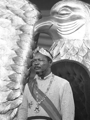 the self-proclamed Emperor of Centrafrican Empire Jean-Bedel Bokassa looks pensive after he crowned himself, 04 December 1977 in Bangui, following Napoleon's example. (BW ONLY) / AFP PHOTO / PIERRE GUILLAUD