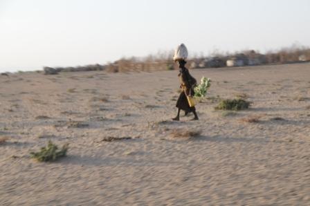 Turkana woman walking in the desert. So HOT!
