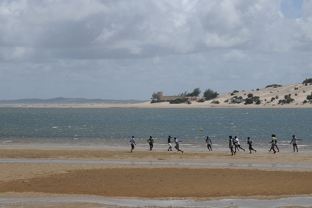 The oldest boys played football at the beach...