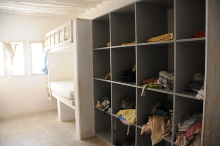 The rooms with the boxes to keep the children's things. Each room sleeps 8 children