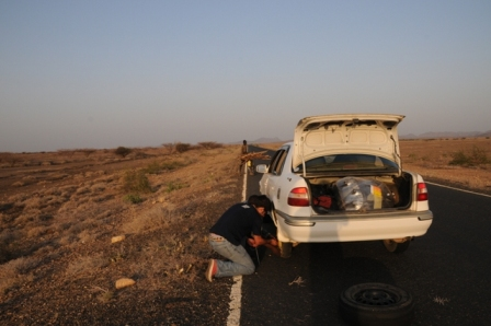 Changing tyres at sunset (for the third time!)