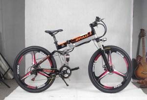 """elscooter zpao elcykel  Elcykel för asfalt där du kan välja att trampa eller gasa med handtaget. Bra komponenter och bra prestanda.- Motor: QS 350 Watt- Batteri: LG 48V/13AH- Räckvidd: Max 60 km- Hastighet: Max 35 km/h- 26"""" hjul. Passar 170-185 cm längd.- Växlar: Shimano Tourney 21 vxl- Dubbbeldämpad med maxvikt 120 kg.- Mått: 180*102*65 cm- Mått ihopfälld: 102*94*40 cm- Integrerat batteri i ramen- Vikt: 20 kg- Gasreglage på högra handtaget- Magnesiumfälgar- Mekaniska bromsar Tektro- Stänkskärmar och pakethållare ingår  Elcykel ZPAO - 350 watt"""