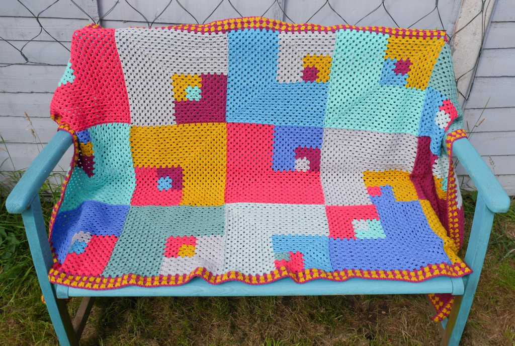 The Unpredictable Granny blanket on a bench