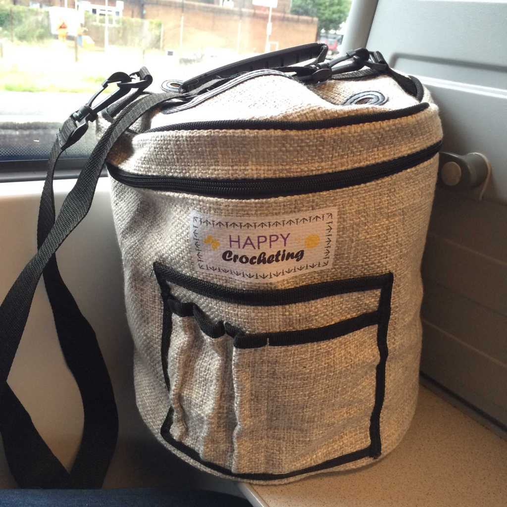 Happy Crocheting yarn drum bag on the train
