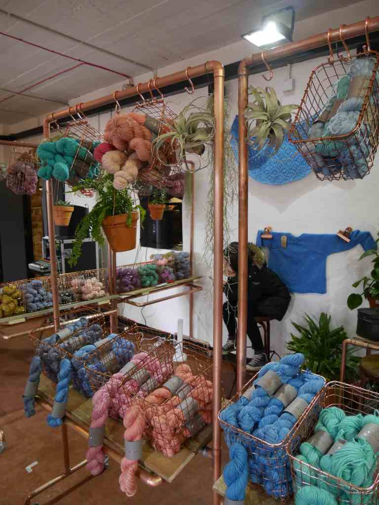 Rose gold yarn stands and succulents at Unravel 2017