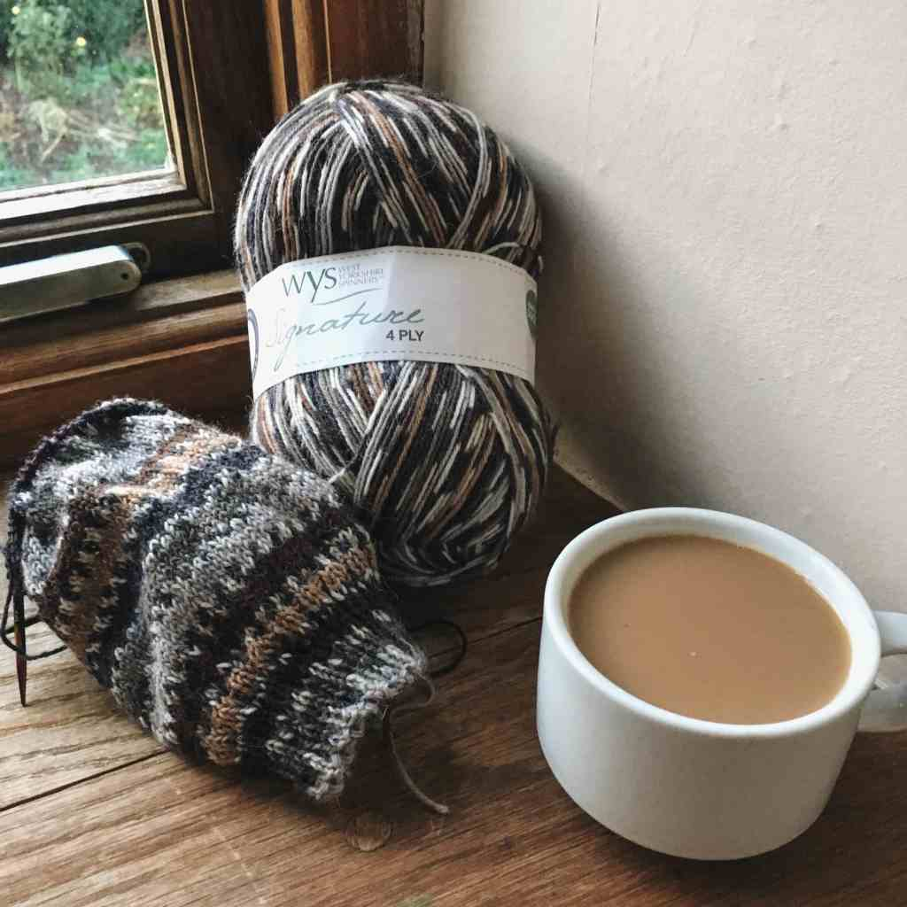 hand knitting socks with a cuppa