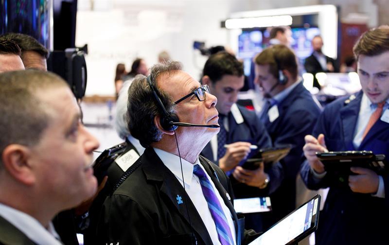 Wall Street registra ganancias y extiende su buen momento