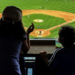 young-baseball-fans-cheering-FHG8VMX