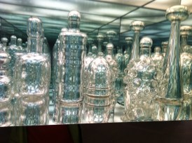 Glass jar and mirrors, myriad reflections