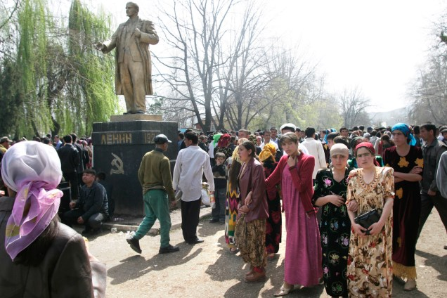 HISSAR, DUSHANBE, TAJIKISTAN - MARCH, 2005: Statue of Lenin looking of a holiday crowd.  For the Muslim festival  of Navrus.  It takes place around the spring equinox (March 21) and is the biggest Central Asia holiday. Most young women in Tajikistan can be seen wearing brightly colored traditional dresses during the holidays. (Photo by Christopher Herwig)