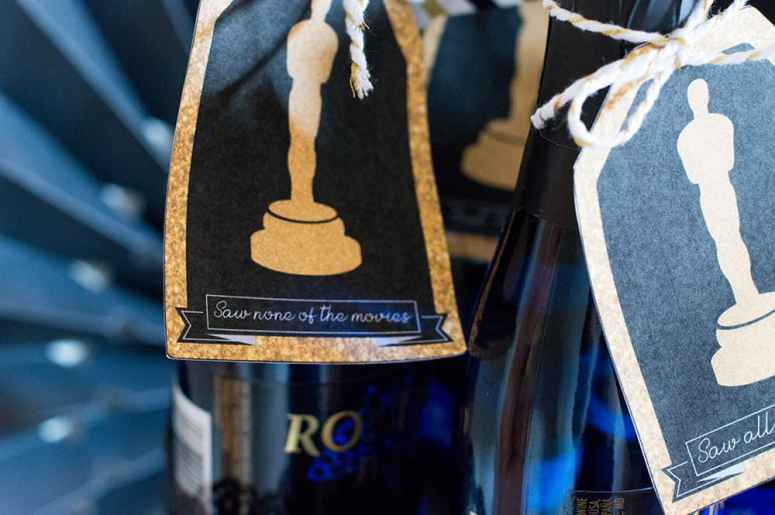 Throw and Oscar Party with these champagne tags