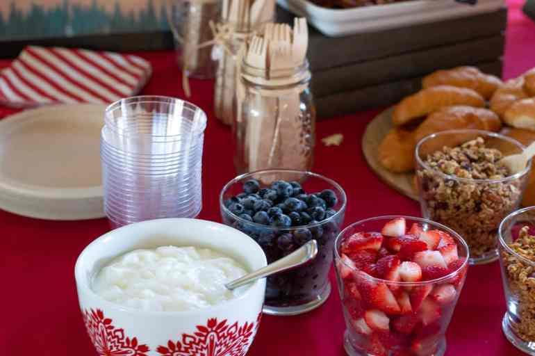 Yogurt parfait bar with toppings served up in little bowls