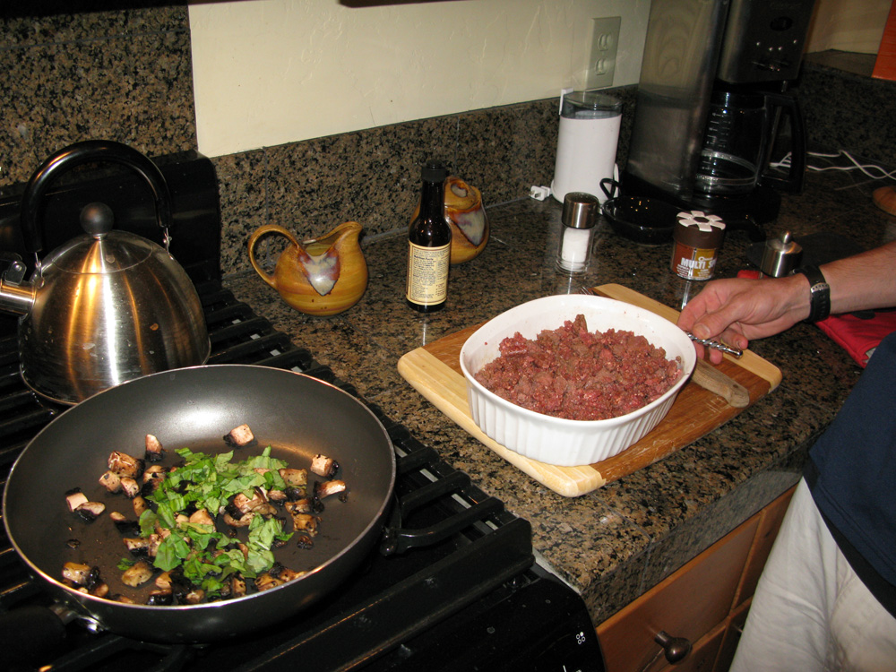 Our elk meat, with mushroom and basil nearby.