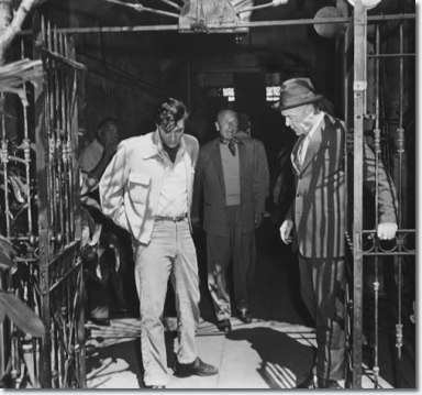 Elvis with Hal Wallis March 3 with Michael Curtiz and Dean Jagger on location