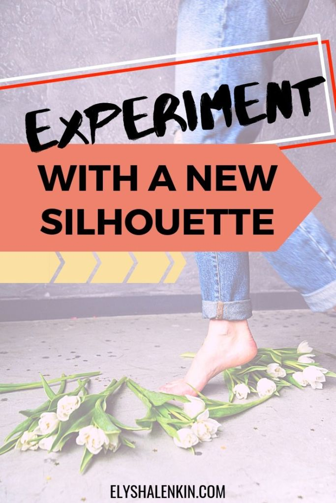 Experiment with a new silhouette. Women walking with cuffed blue jeans over flowers.