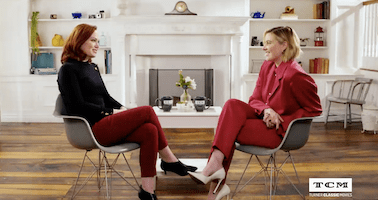 Turner Classics still shot of Alicia Malone and Greta Gerwig sitting for a tv interview