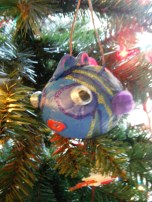 here is a papier mache fish displayed as an ornamnet